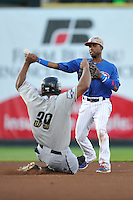 Arismendy Alcantara #5 of the Iowa Cubs throw to first base against the Omaha Storm Chasers at Principal Park on July 2, 2014 in Des Moines, Iowa. The Cubs  beat Storm Chasers 4-3.   (Dennis Hubbard/Four Seam Images)
