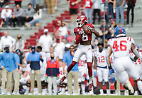 Arkansas wide receiver Mike Woods (8) completes a pass, Saturday, October 17, 2020 during the first quarter of a football game at Donald W. Reynolds Razorback Stadium in Fayetteville. Check out nwaonline.com/201018Daily/ for today's photo gallery. <br /> (NWA Democrat-Gazette/Charlie Kaijo)
