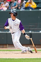 Martin Medina (21) of the Winston-Salem Dash follows through on his swing against the Frederick Keys at BB&T Ballpark on May 18, 2014 in Winston-Salem, North Carolina.  The Dash defeated the Keys 7-6.  (Brian Westerholt/Four Seam Images)