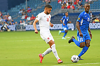 KANSASCITY, KS - JULY 11: Jonathan Osorio #21 of Canada passes the ball during a game between Canada and Martinique at Children's Mercy Park on July 11, 2021 in KansasCity, Kansas.