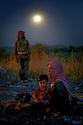 Syria 2014  <br /> August 15, a Yezidi family waiting by night their relatives before crossing the Pesh Kabur's bridge to reach the Kurdistan of Iraq  <br /> Syrie 2014 <br /> 15 aout, la nuit, une famille yezidiattendant le reste de leur famille avant de traverser le pont de Pesh Kabur pour entrer au Kurdistan irakien.