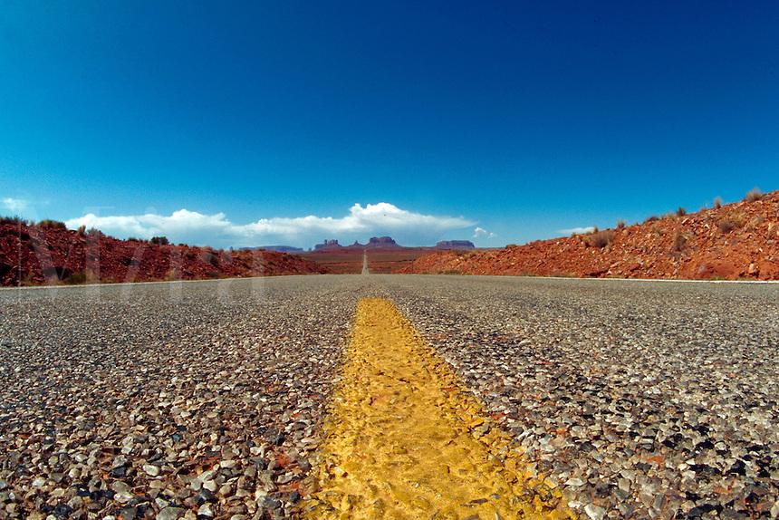 Detail of deserted road stretching to horizon, Monument Valley, Arizona