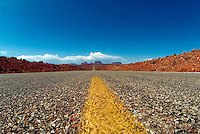 Detail of deserted road stretching to horizon, Monument Valley, Arizona