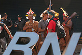 Indigenous people protest outside BNDES, the Brazilian National Development Bank, about developments financed by the bank which adversely affect indigenous people with security guards monitoring the situation after a march from the People's Summit at the United Nations Conference on Sustainable Development (Rio+20), Rio de Janeiro, Brazil, 18th June 2012. Photo © Sue Cunningham.