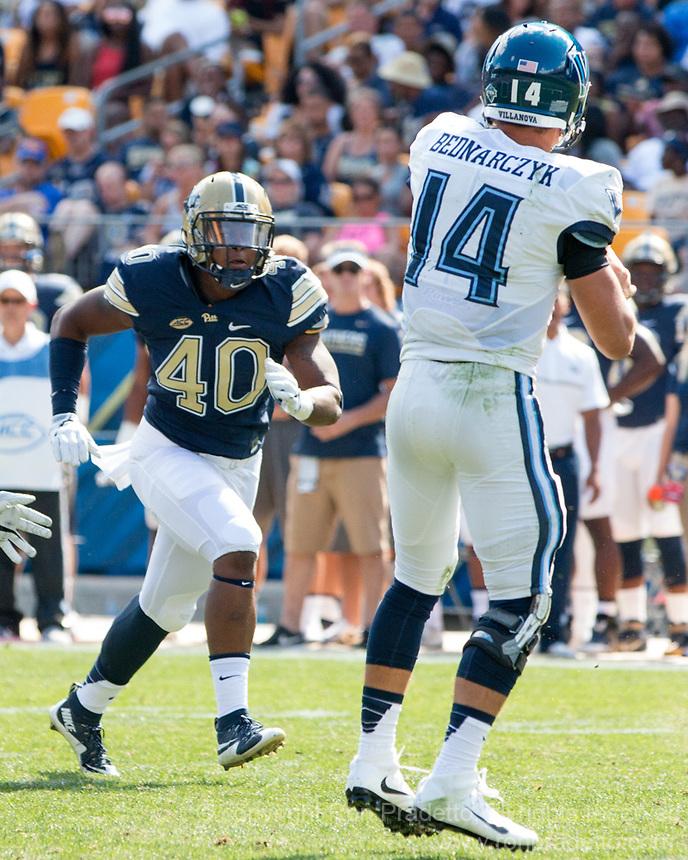 Pitt defnesive lineman James Folston rushes the quarterback. The Pitt Panthers defeated the Villanova Wildcats 28-7 at Heinz Field, Pittsburgh, Pennsylvania on September 3, 2016.