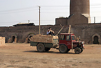 A brickkiln in Bazhou, Hebei province, China. The brickkiln was built during Mao's the Great Leap Forward campaign in 1958. With a rapid ecomomic growth in China, more than 120,000 bricks are made from the brickkiln  per day nowdays, though clay bricks has been prohibited from using in more than 170 cities of China since 2002 to protect the fertile land..04-SEP-04