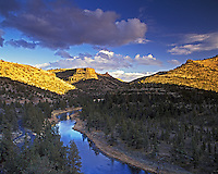 Sunset on Crooked River with leftover storm clouds. Oregon.