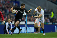 Cory Jane of New Zealand prepares to hand off Mike Brown of England during the QBE Autumn International match between England and New Zealand at Twickenham on Saturday 01 December 2012 (Photo by Rob Munro)