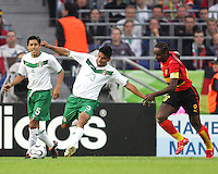 Carlos Salcido (3) of Mexico clears the ball before Akwa (10) of Angola moves in. Mexico and Angola played to a 0-0 tie in their FIFA World Cup Group D match at FIFA World Cup Stadium, Hanover, Germany, June 16, 2006.