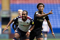 Bolton Wanderers' Nathan Delfouneso competing with Oldham Athletic's Sido Jombati (right) <br /> <br /> Photographer Andrew Kearns/CameraSport<br /> <br /> The EFL Sky Bet League Two - Bolton Wanderers v Oldham Athletic - Saturday 17th October 2020 - University of Bolton Stadium - Bolton<br /> <br /> World Copyright © 2020 CameraSport. All rights reserved. 43 Linden Ave. Countesthorpe. Leicester. England. LE8 5PG - Tel: +44 (0) 116 277 4147 - admin@camerasport.com - www.camerasport.com