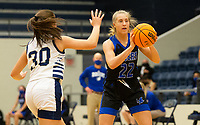 Kate Miller (22) of Rogers passes the ball as Savannah Rangel (30) of Bentonville West defends at Wolverine Arena, Centerton,  AR, Tuesday, January 12, 2021 / Special to NWA Democrat-Gazette/ David Beach
