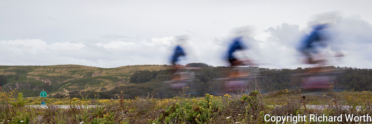 """Composite of three images of a rider, a participant in the AIDS Lifecycle """"Ride to End AIDS"""" on Highway 1 south of San Francisco."""
