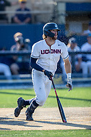 Connecticut Huskies outfielder Chris Winkel (11) follows through on his swing during the NCAA tournament against the Michigan Wolverines on June 4, 2021 at Frank Eck Stadium in Notre Dame, Indiana. The Huskies defeated the Wolverines 6-1. (Andrew Woolley/Four Seam Images)