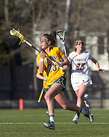 University of Vermont midfielder Adison Rounds (23) brings the ball forward. Boston College defeated University of Vermont, 15-9, at Newton Campus Field, April 4, 2012.