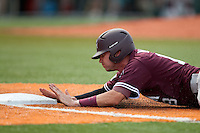 Texas A&M Aggies outfielder Tyler Naquin #18 dives back to first base during the NCAA baseball game against the Texas Longhorns on April 28, 2012 at UFCU Disch-Falk Field in Austin, Texas. The Aggies beat the Longhorns 12-4. (Andrew Woolley / Four Seam Images)..