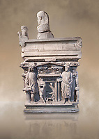 """End panel of a Roman relief sculpted sarcophagus with kline couch lid with a reclining male figuer depicted, """"Columned Sarcophagi of Asia Minor"""" style typical of Sidamara, 3rd Century AD, Konya Archaeological Museum, Turkey. Against a warm art background."""