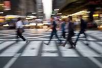 AVAILABLE FOR COMMERCIAL OR EDITORIAL LICENSING FROM GETTY IMAGES.  Please go to www.gettyimages.com and search for image # 158771973.<br /> <br /> Blurred Motion Busy Street Scene of Commuters Leaving Work During the Evening Rush Hour, 42nd Street, Midtown Manhattan, New York City, New York State, USA