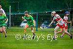 Kerry's Rachel McCarthy gets the sliotar out of danger as Megan Kerr of Derry bares down on her,  in the Intermediate Camogie championship
