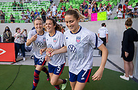 AUSTIN, TX - JUNE 16: Emily Sonnett #14, Kelley O'Hara #5 and Abby Dahlkemper #7 of the USWNT enter the field before a game between Nigeria and USWNT at Q2 Stadium on June 16, 2021 in Austin, Texas.