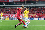 Shanghai FC Defender Fu Huan (L) in action against Jiangsu FC Defender Li Ang (R) during the AFC Champions League 2017 Round of 16 match between Shanghai SIPG FC (CHN) vs Jiangsu FC (CHN) at the Shanghai Stadium on 24 May 2017 in Shanghai, China. Photo by Marcio Rodrigo Machado / Power Sport Images