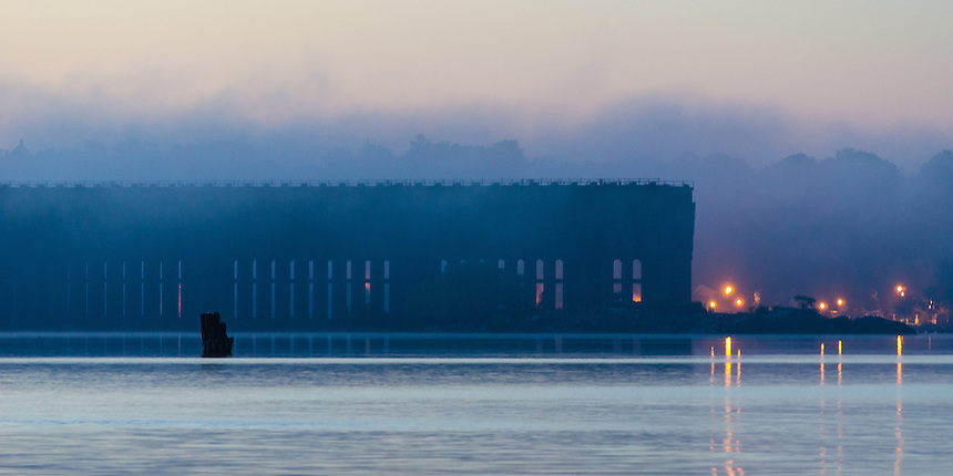 A view of the historic Lower Harbor Iron Ore Dock through the evening fog on Lake Superior. Marquette, MI