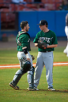 Farmingdale Rams catcher Kenneth Johntry (18) talks with relief pitcher Ryan O'Connor (27) during a game against the Union Dutchmen on February 21, 2016 at Chain of Lakes Stadium in Winter Haven, Florida.  Farmingdale defeated Union 17-5.  (Mike Janes/Four Seam Images)