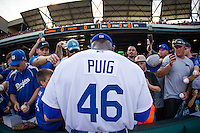 Oklahoma City Dodgers Yasiel Puig (46) signs autographs  prior to his first home game in Oklahoma City against the El Paso Chihuahuas at Chickasaw Bricktown Ballpark on August 12, 2016 in Oklahoma City, Oklahoma. Oklahoma City defeated El Paso 8-4.  (William Purnell/Four Seam Images)