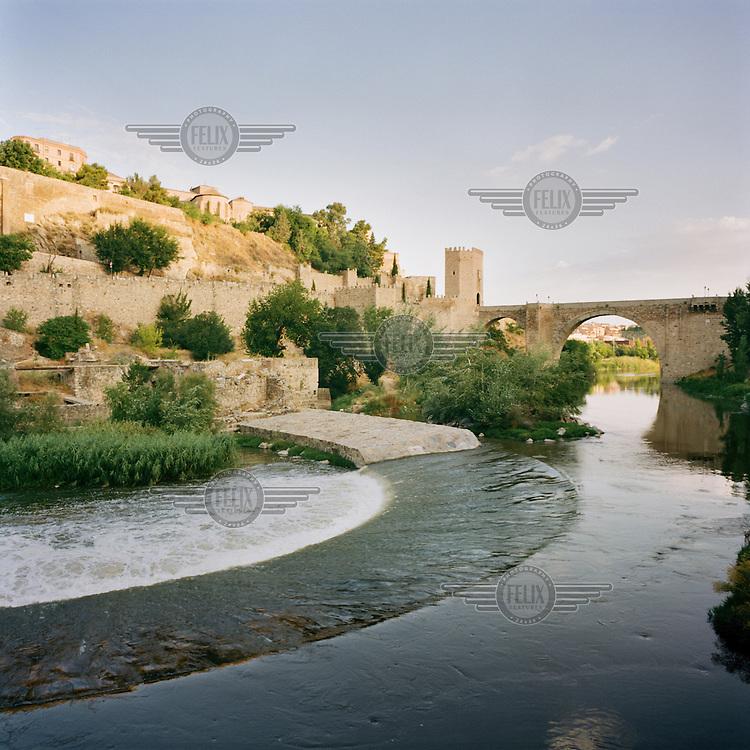 The river Tajo where it is crossed by the Alcantara Bridge outside Toledo.