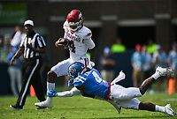 Arkansas quarterback Malik Hornsby (4) carries the ball as Ole Miss defensive back Tylan Knight (4) covers, Saturday, October 9, 2021 during the second quarter of a football game at Vaught Hemingway Stadium in Oxford, Miss. Check out nwaonline.com/211010Daily/ for today's photo gallery. <br /> (NWA Democrat-Gazette/Charlie Kaijo)