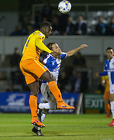 Aaron Pierre of Wycombe Wanderers beats Stuart Sinclair of Bristol Rovers to the ball during the Johnstone's Paint Trophy match between Bristol Rovers and Wycombe Wanderers at the Memorial Stadium, Bristol, England on 6 October 2015. Photo by Andy Rowland.