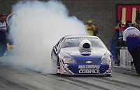 Oct. 31, 2008; Las Vegas, NV, USA: NHRA pro stock driver Kurt Johnson does a burnout during qualifying for the Las Vegas Nationals at The Strip in Las Vegas. Mandatory Credit: Mark J. Rebilas-