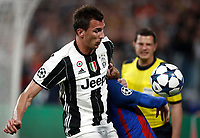 Football Soccer: UEFA Champions UEFA Champions League quarter final first leg Juventus-Barcellona, Juventus stadium, Turin, Italy, April 11, 2017. <br /> Juventus Mario Mandzukic (l) in action with Barcellona's Lionel Messi (r) during the Uefa Champions League football match between Juventus and Barcelona at the Juventus stadium, on April 11 ,2017.<br /> UPDATE IMAGES PRESS/Isabella Bonotto