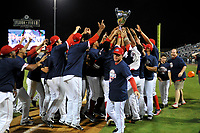 Manager Darren Fenster hands off the trophy as Greenville Drive players celebrate their 2017 South Atlantic League Championship following an 8-3 win over the Kannapolis Intimidators in Game 4 of the Championship Series on Friday, September 15, 2017, at Fluor Field at the West End in Greenville, South Carolina. It was Greenville's first SAL Championship. Greenville won the series 3-1. (Tom Priddy/Four Seam Images)