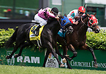 LOUISVILLE, KY - MAY 07: Camelot Kitten #9, ridden by Irad Ortiz Jr., wins the American Turf after edging out Beach Patrol #4, ridden by Flavian Prat on May 7, 2016 in Louisville, Kentucky. (Photo by Zoe Metz/Eclipse Sportswire/Getty Images)