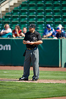 Home plate umpire Phil Bando during the game as the Idaho Falls Chukars faced the Ogden Raptors in Pioneer League action at Lindquist Field on July 2, 2017 in Ogden, Utah. Ogden defeated Idaho Falls 6-5. (Stephen Smith/Four Seam Images)