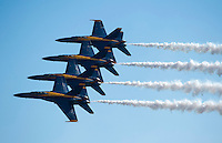 """121014-N-DR144-844 SAN DIEGO (October 14, 2012)- F/A-18C Hornets assigned to the U.S. Navy flight demonstration squadron, the Blue Angels, perform during the Marine Corps Air Station Miramar 2012 Air Show. The air show, held October 12-14, was themed """"Marines In Flight: Celebrating 50 Years of Space Exploration."""" (U.S. Navy photo by Mass Communication Specialist 1st Class James R. Evans / RELEASED)"""