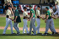Siena Saints players, including Ryan Stefaniak (15) and Carlos Tapia (29), shake hands with UCF Knights players, including Eli Putnam (34), Matthew Mika (2), Sam Crooker (17), and Trent Thompson (42), after a game on February 21, 2016 at Jay Bergman Field in Orlando, Florida.  UCF defeated Siena 11-2.  (Mike Janes/Four Seam Images)