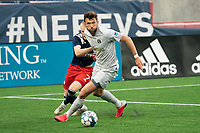 FOXBOROUGH, MA - APRIL 17: Jalen Crisler #15 of Richmond Kickers breaks free off Connor Presley #7 of New England Revolution II during a game between Richmond Kickers and Revolution II at Gillette Stadium on April 17, 2021 in Foxborough, Massachusetts.
