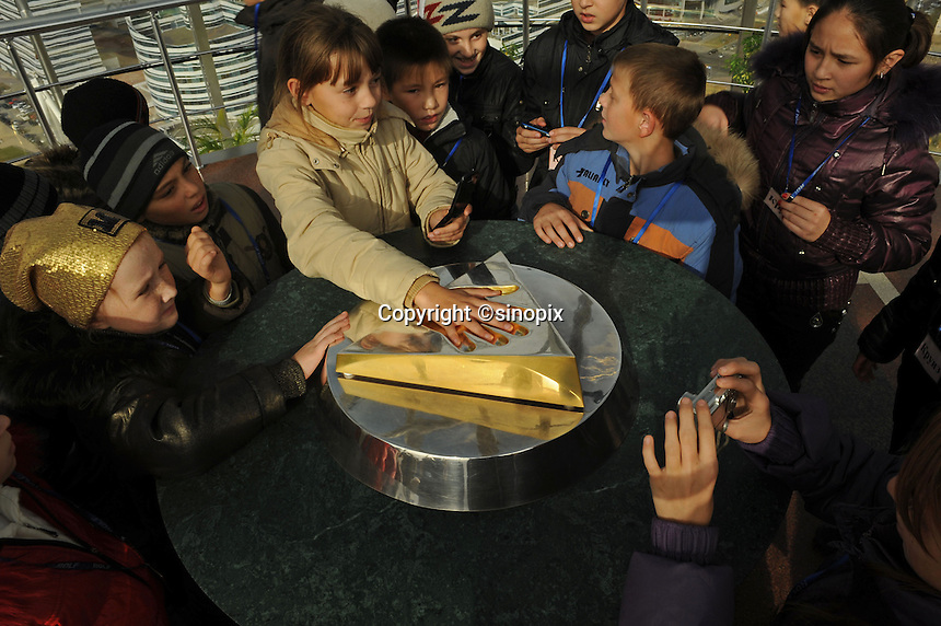 Children put their hands into the print of the country's leader Nursultan Nazaarbayev in the top of the Bayterek tower in Astana, the capitol of Kazakstan.<br /> <br /> PHOTO BY RICHARD JONES/SINOPIX