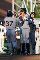 Mahoning Valley Scrappers catcher Diego Seastrunk (37) is greeted after hitting a home run by Giovanny Urshela (10) during a game vs. the Jamestown Jammers at Russell Diethrick Park in Jamestown, New York June 20, 2010.   Mahoning Valley defeated Jamestown 9-2.  Photo By Mike Janes/Four Seam Images