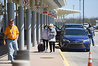 Flyers make their way to their flight, Friday, April 2, 2021 at the Northwest Arkansas National Airport in Bentonville. Check out nwaonline.com/210403Daily/ for today's photo gallery. <br /> (NWA Democrat-Gazette/Charlie Kaijo)