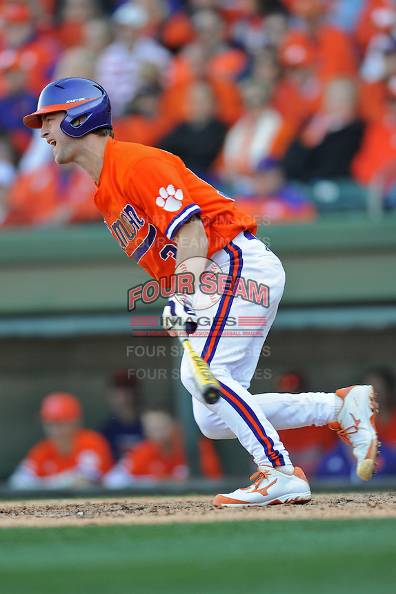 Clemson Tigers designated hitter Garrett Boulware #30 swings at a pitch during a game against the South Carolina Gamecocks at Fluor Field on March 1, 2014 in Greenville, South Carolina. The Gamecocks defeated the Tigers 10-2. (Tony Farlow/Four Seam Images)