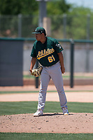 Oakland Athletics relief pitcher Jorge Martinez (61) looks to his catcher for the sign during an Extended Spring Training game against the San Francisco Giants Orange at the Lew Wolff Training Complex on May 29, 2018 in Mesa, Arizona. (Zachary Lucy/Four Seam Images)