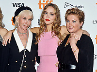 """16 September 2021 - Toronto, Ontario, Canada - Trudie Styler, Lily-Rose Depp. and Camille Griffin. 2021 Toronto International Film Festival - """"Silent Night"""" Premiere held at Roy Thomson Hall. Photo Credit: Brent Perniac/AdMedia"""