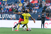 FOXBOROUGH, MA - AUGUST 4: Gustavo Bou #7 of New England Revolution on the attack as Brian Anunga #27 of Nashville SC defends during a game between Nashville SC and New England Revolution at Gillette Stadium on August 4, 2021 in Foxborough, Massachusetts.