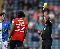 11th September 2021; Ewood Park, Blackburn, Lancashire England; EFL Championship football, Blackburn Rovers versus Luton Town; Gabriel Osho of Luton Town is shown a yellow card by referee Oliver Langford