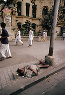 Calcutta, India. A child beggar sleeps on the street - - Child labor as seen around the world between 1979 and 1980 - Photographer Jean Pierre Laffont, touched by the suffering of child workers, chronicled their plight in 12 countries over the course of one year.  Laffont was awarded The World Press Award and Madeline Ross Award among many others for his work.