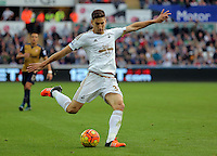 Federico Fernandez of Swansea crosses the ball forward during the Barclays Premier League match between Swansea City and Arsenal at the Liberty Stadium, Swansea on October 31st 2015