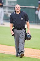 Home plate umpire Garret Corl between innings of the South Atlantic League game between the Hickory Crawdads and the Kannapolis Intimidators at Fieldcrest Cannon Stadium August 17, 2010, in Kannapolis, North Carolina.  Photo by Brian Westerholt / Four Seam Images
