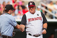 Kannapolis Intimidators manager Tommy Thompson #39 shakes hands with home plate umpire Blake Felix prior to the South Atlantic League game against the West Virginia Power at Fieldcrest Cannon Stadium on April 20, 2011 in Kannapolis, North Carolina.   Photo by Brian Westerholt / Four Seam Images